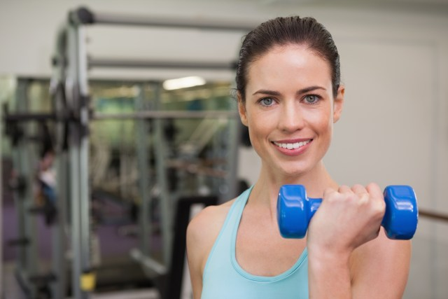 Female-Bicep-Curl-Dumbbell-Weights-Gym-Smiling