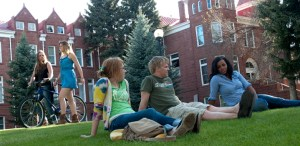 students-sitting-in-grass-720x350