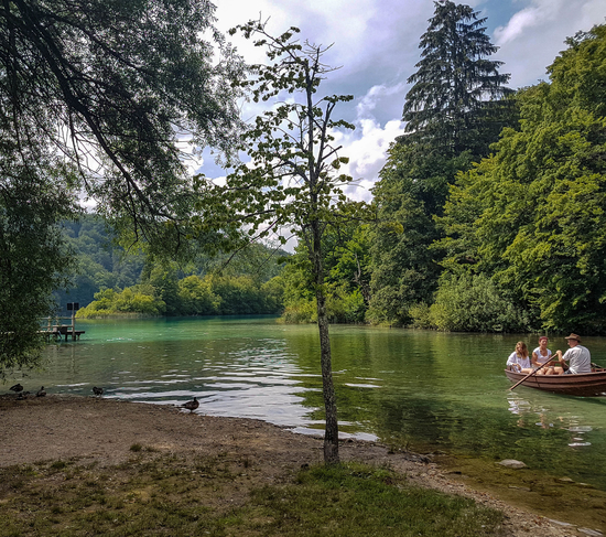 The view on shallow lake waters in Plitvice and boat facility transport
