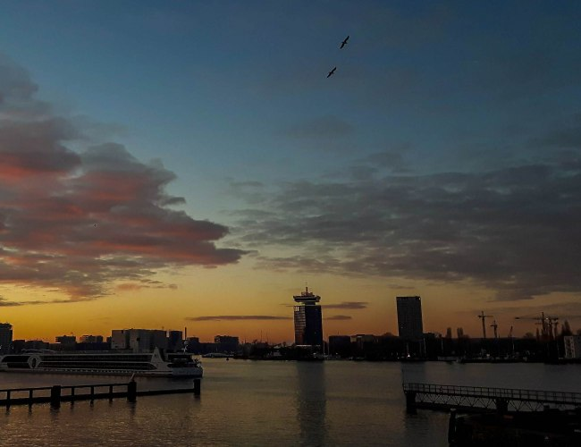 Amazing sunset view over the IJ river in Amsterdam and Amsterdam LOOKOUT