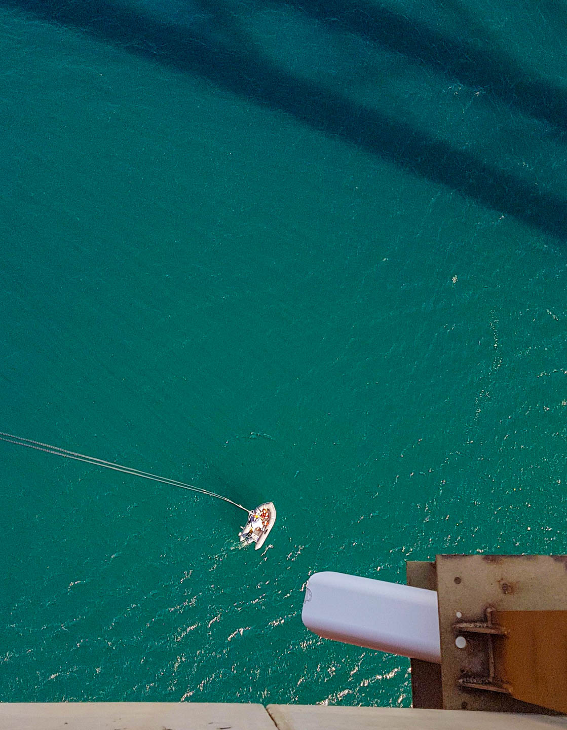 Small boat on Adriatic sea still tied with a bungee rope