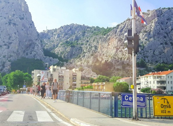 Famous bridge in Omis over Cetina river and the view on mountains