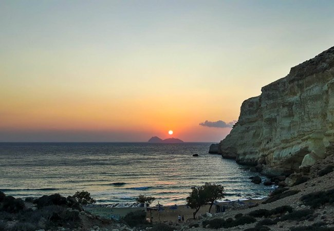 Sunset time in Red Sand beach near Matala in Crete island