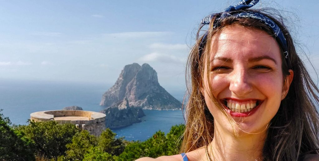 Es Vedra Ibiza and a girl smiling