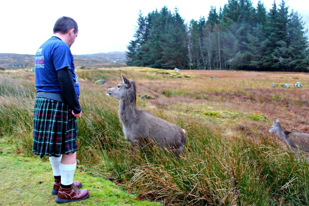 Highland fairytale: our knight-in-kilt getting to know the local deer in Glencoe