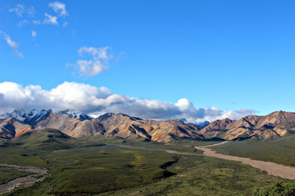 #ExploreTheElements: Earth. Photo of the Alaska Range in Denali National Park.  Blue skies with scattered clouds.