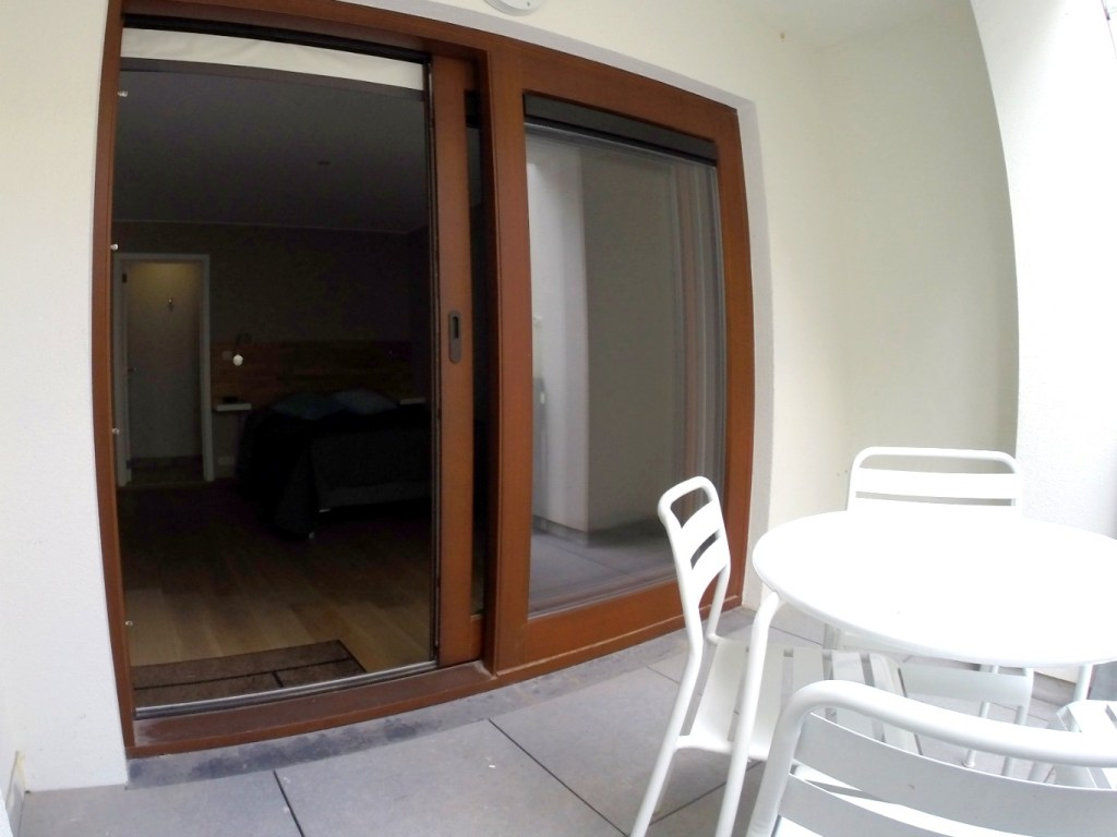 Airbnb Brussels: large balcony and seating area