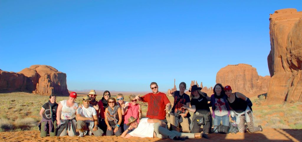 Solo travel: Trek America group photo in Monument Valley, USA