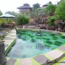 Swimming pool in front of villas