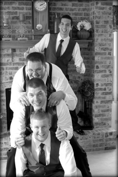 Pile of Best Men with Groom on the side