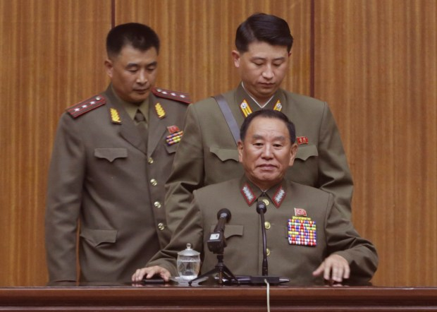 """North Korea's General Reconnaissance Bureau Director Kim Yong Chol, bottom, takes his seat prior to the start of a briefing for foreign diplomats regarding the latest situation at the border between the two Koreas at the People's Cultural House in Pyongyang, North Korea, Friday, Aug. 21, 2015. North Korean leader Kim Jong Un on Friday declared his frontline troops in a """"quasi-state of war"""" and ordered them to prepare for battle a day after the most serious confrontation between the rivals in years. (AP Photo/Dita Alangkara)"""