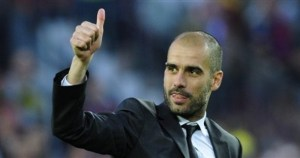 FC Barcelona's coach Josep Guardiola gives his thumbs up after winning the Spanish La Liga league title at the end of the Spanish La Liga soccer match against Valladolid at the Camp Nou stadium in Barcelona, Spain, Sunday, May 16 , 2010. (AP Photo/Manu Fernandez)