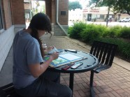 Mikayla enjoying the ease of watercolors in downtown Waterford.