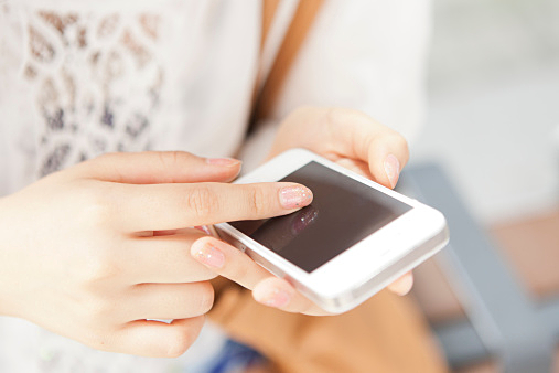 Young woman using smartphone,Close-up