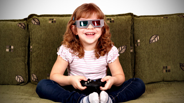 happy little girl with 3d glasses play video game