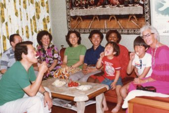 The Ha family and their guests snack on melon and possibly tomatoes.