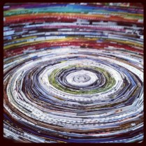 """Recycled magazine pages 14"""" in diameter at the top."""