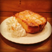 """Jumbo French Toast"" and whipped cream."