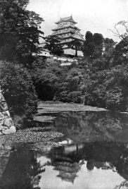 AN OLD FEUDAL CASTLE FROM THE MOAT In lotus-land Japan, 1910 by H.G.Ponting