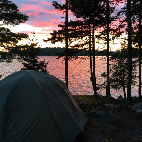 Cotton candy sky over tent