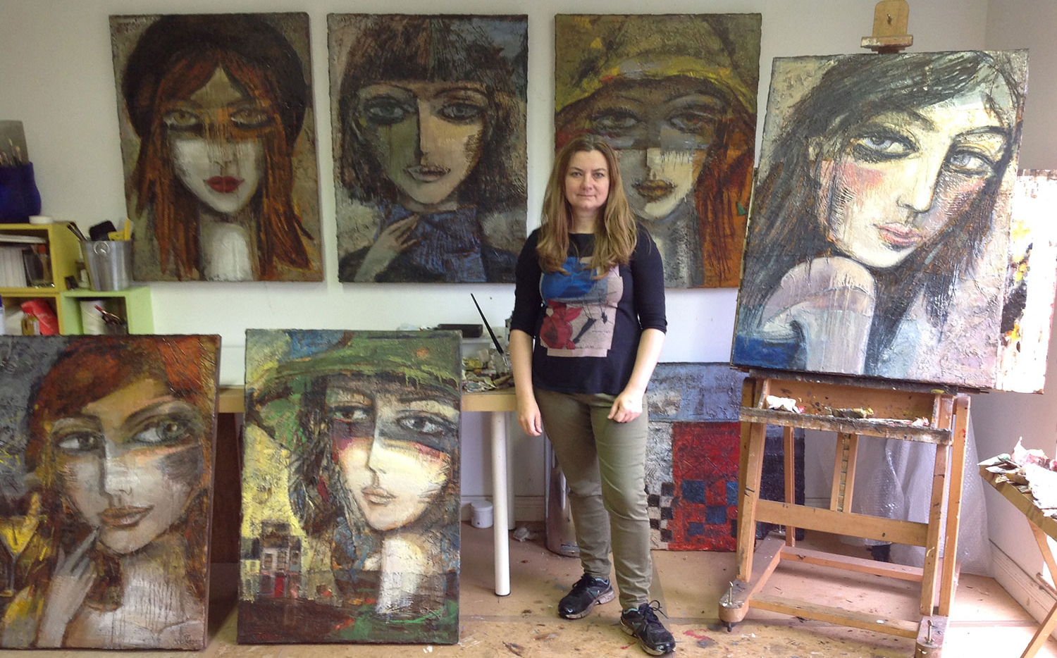Photo of Dublin Artist Ludmila Korol with large scale figurative paintings in oil on canvas