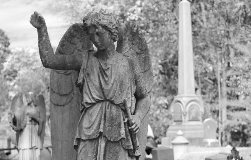 grayscale statue of an angel