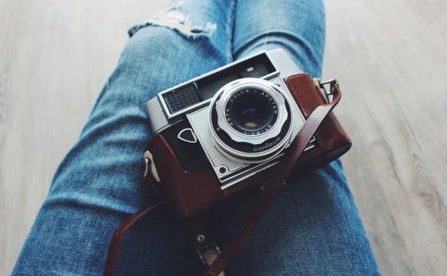 Film camera on jeans