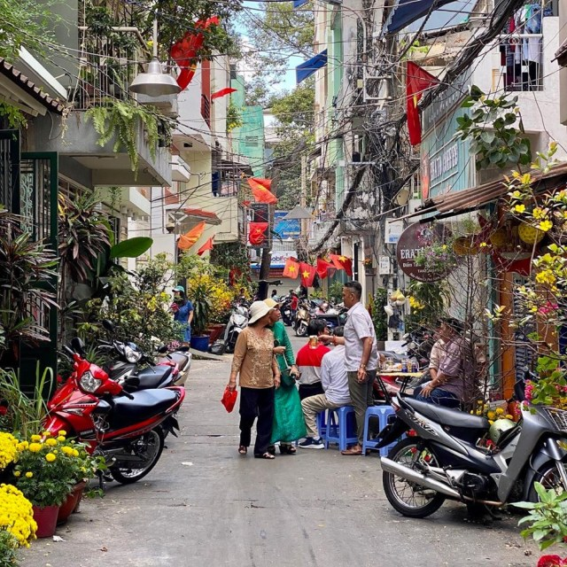 Families celebrating in Saigon on the first day of Tet