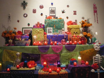 Impressively multicolored altar for Día de Muertos. Anything else but black, which is the norm in my country. Even the skulls were made entirely out of sugar!