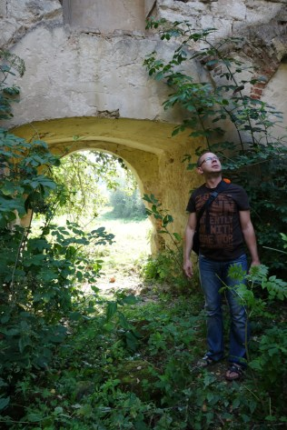 Darek surveys the church's interior, just inside the main door.