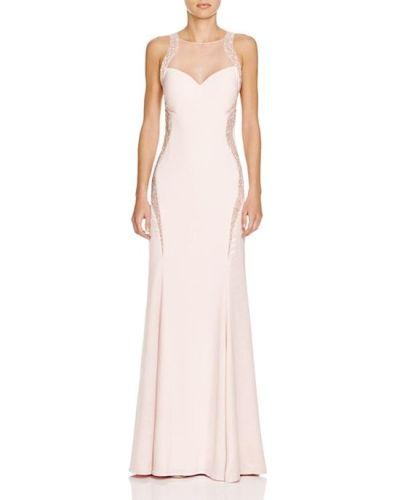 Vestido de novia rosado y detalles laterales de Mignon, 418 euros.