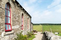 The-Chapel-holiday-cottage-red-window-frames-and-stone-walls