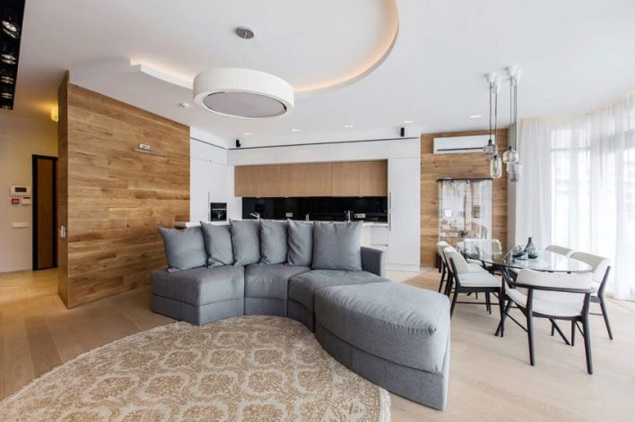 Curving-sofa-and-dining-room-view