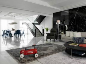 Dining-area-neighboring-the-staircase-looks-rather-futuristic-900x675