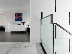 Textured-wall-panels-are-used-masterfully-to-give-the-minimal-apartment-plenty-of-detail-900x675