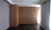 Urban-Hermitage-studio-has-L-shaped-wooden-wall-unit
