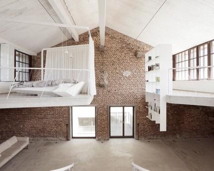 Reinvented-loft-in-Austria-retains-the-original-brick-walls