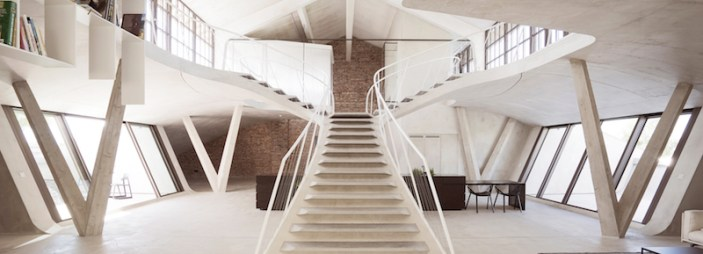 Reinvented-loft-in-Austria-with-concrete-staircase-and-fluid-lines