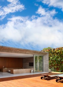 An-House-opens-to-the-deck-and-pool-through-sliding-glass-walls