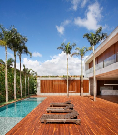 An-House-with-a-large-deck-that-surrounds-the-pool