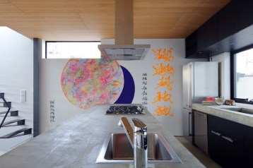 Small-house-in-Kyoto-has-a-concrete-kitchen-island