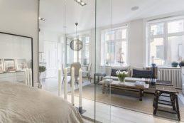 Small-Flat-in-Stockholm-Bedroom-Transparent-Walls1-768x511