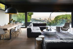ARRCC-remodeled-residence-has-a-living-area-that-opens-onto-a-terrace