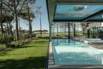 trees-and-lawn-national-park-concrete-home