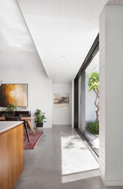 Pre-war-house-extension-features-sliding-glass-doors-and-concrete-floors