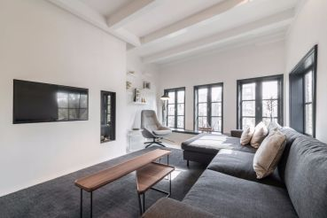 Living-room-with-more-versatile-set-of-two-wooden-tables