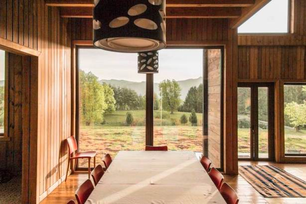 Holiday-home-in-Chile-has-a-large-window-in-the-dining-area