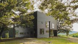 Holiday-home-in-Chile-is-shaped-like-a-cube-and-has-small-windows
