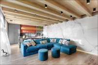 turquoise-block-couch-marble-wall-buddhist-home