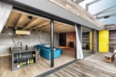 wood-panels-open-sliding-doors-indoor-outdoor-flow-home